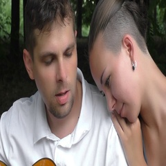 Happy couple playing and listening guitar outdoor Stock Footage
