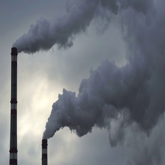 Footage industrial chimneys emits toxic pollutants into the sky polluting the Stock Footage