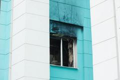Window a fire in high-rise building Kuvituskuvat