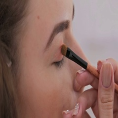 Close up shot. Professional make-up artist applying eyeshadow Stock Footage