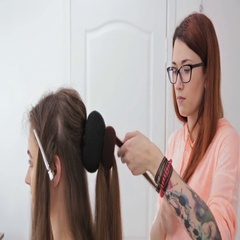 Professional hairdresser doing hairstyle for young pretty woman with long hair Stock Footage