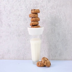Stack of chocolate chip cookies on a plate on top of glass of milk. Stock Footage