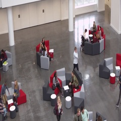 Overhead handheld shot of students in university lobby, shot on R3D Stock Footage