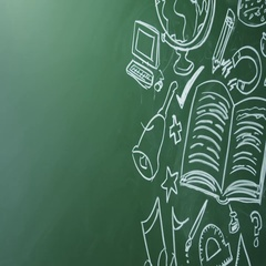 School subjects drawn on chalkboard, pan right from space, shot on R3D Stock Footage