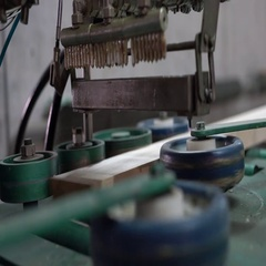 Manufacturing. View of applying adhesive to timber Stock Footage