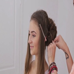 Professional hairdresser doing hairstyle for young pretty woman Stock Footage