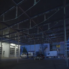 Lights on the roof of the parking lot are turned on Stock Footage