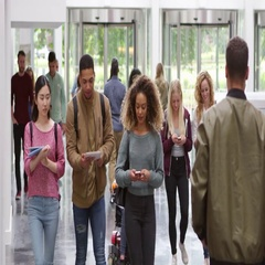 Students walking through the foyer of a modern university, shot on R3D Stock Footage