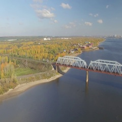 The railway bridge on which the train rides. Aerial view. Stock Footage