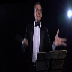 Kapellmeister conducting an orchestra emotionally Stock Footage