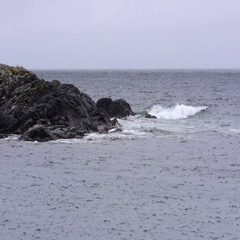 Waves on Rocks on a Dreary Day Stock Footage