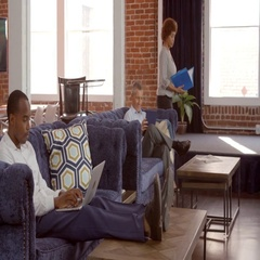 Relaxation Area Of Office With Staff Having Informal Meeting Stock Footage