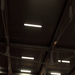 Night lights on the sun protection system in a parking lot Stock Footage