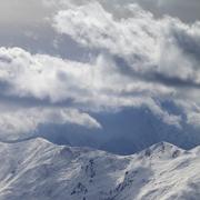 Evening mountains and sunlight cloudy sky Stock Photos