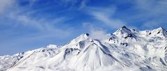 Panoramic view of winter snowy mountains at windy day Stock Photos