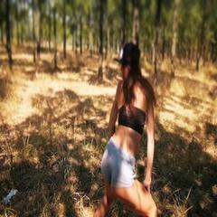 Very sexy girl in denim shorts dancing twerk in the forest Stock Footage