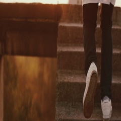 Black man running through the stairs on the roof towards sunset,sunrise,full HD Stock Footage