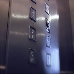 Dramatic hand press the 4th floor button in the elevator Stock Footage