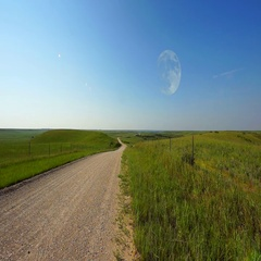 Moon Over Prairie Road in Day Stock Footage
