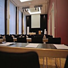 Big conference room with projector canvas from behind empty seat Stock Footage