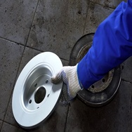 Skilled mechanic hand put old brake disk and take new one Stock Footage