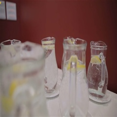 Water with lemon in glass jug Stock Footage