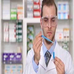 Druggist Man in Pharmacy Laboratory Drugs Preparation Analyzing Liquid Medicine Stock Footage