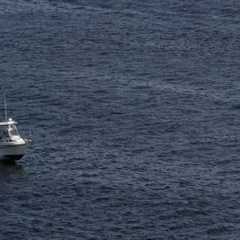 Small boat speeding across the water Stock Footage