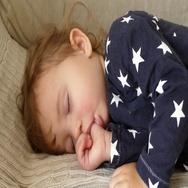 Sleeping baby, sucking thumb Stock Footage
