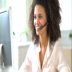 Portrait of customer service assistant talking on phone Stock Footage