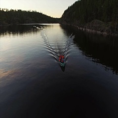 Unrecognizable people in boat at evening aerial shot Stock Footage
