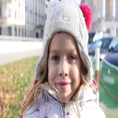 Cute little blonde kid girl portrait stay smile posing to camera outdoors Stock Footage