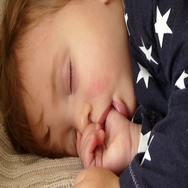 Sleeping baby, chuld sucking finger, thumb close up Stock Footage