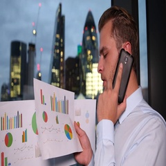 Busy Businessman Looking Pie Chart Talking Mobile Positive Report London Skyline Stock Footage