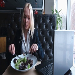 Young business woman eating salad. Enjoying  a meal at lunch Stock Footage