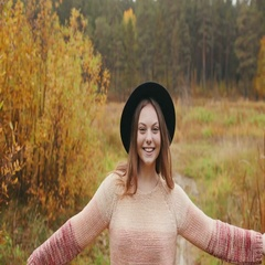Beautiful girl in a black hat dancing in the autumn forest Stock Footage