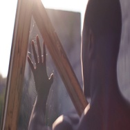 Black man standing outdors on the old factory, looking at his hand, touching the Stock Footage