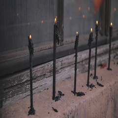Black candles burn smoothly. The decor in an abandoned building Stock Footage