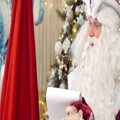 Santa Claus and helper learning gift list. Stock Footage
