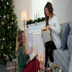 Packaging presents, Girlfriends are preparing for the New Year holiday. Stock Footage