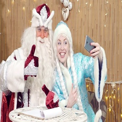 Santa Claus and helper playing the phone and communicating on the network. Stock Footage