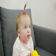 Little girl playing on the couch at the living room Stock Footage