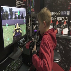 Boy playing race video game on a big screen. Arkistovideo