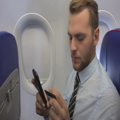 Attractive Businessman Purchase Online to a Credit Card and Phone Airplane Cabin Stock Footage