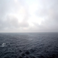View of ocean and clouds from back of boat Stock Footage