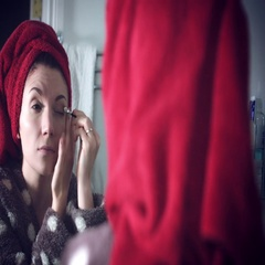 4k Authentic Shot of a Woman Applying Makeup on Eyes Stock Footage