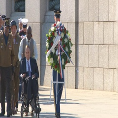 Senator Bob Dole is pushed during WWII ceremony in Washington, D.C.  Arkistovideo