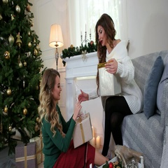 Girlfriends are preparing for the New Year holiday, packaging presents. Stock Footage