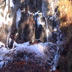 4k Upcoming winter first frost Radau waterfall tilt up sunny Harz mountain range Stock Footage