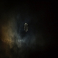 Moon on cloudy sky 4k timelapse Stock Footage